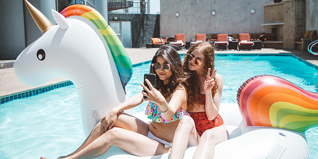 Women on floating Unicorn in the pool at the Hotel Angeleno